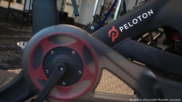 A file photo shows the Peloton logo on the company's stationary bicycle