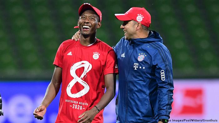 David Alaba and coach Hansi Flick celebrate winning the 2019-20 Bundesliga title