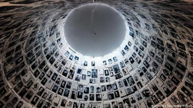 Israel Jerusalem Yad Vashem ceiling in a hall covered with photos of faces.
