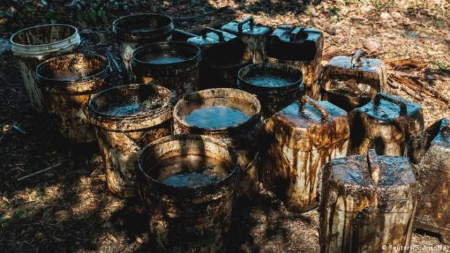 Spilled oil collected in barrels in Mauritius