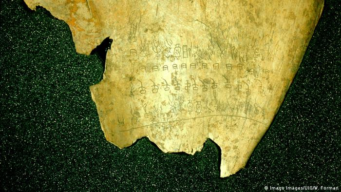 The engraved characters here are the earliest known examples of Chinese script: what looks like gold-plated bones with Chinese characters.
