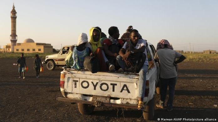 Ethiopian refugees in a truck in Sudan