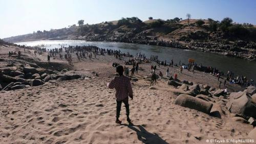 Ethiopians who fled Tigray at the Setit River on the Sudan-Ethiopian border