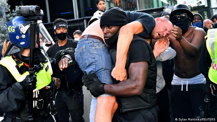 Patrick Hutchinso tries to rescue an injured man in London during a Black Lives Matter demonstration.