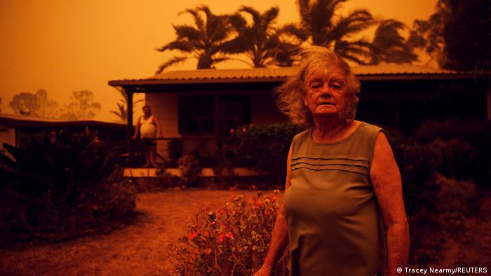 Nancy and Brian Allen outside their home amid the fires in New South Wales, Australia.
