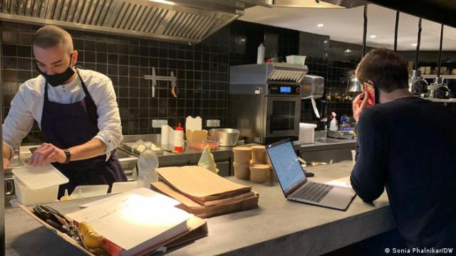 A chef works at a counter at a restaurant in France.