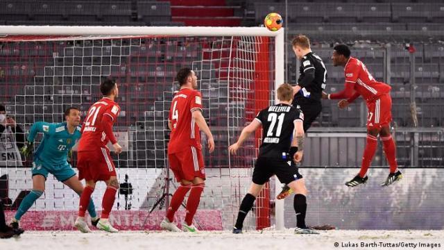 Amos Pieper of Arminia Bielefeld scores against Bayern Munich.