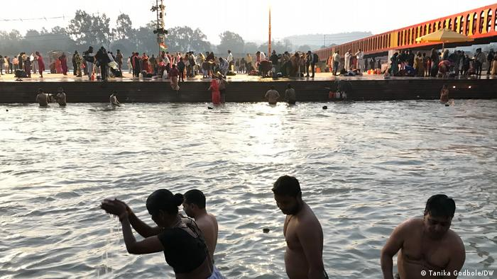 People bathe in the Ganges River at the Kumbh Mela festival in Haridwar