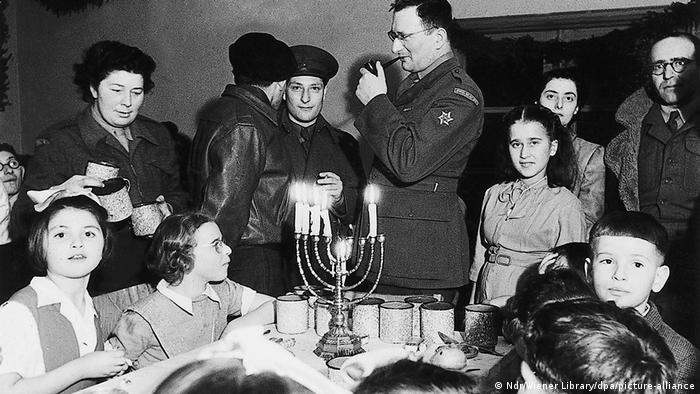 Surviving Jews holding a Chanukah celebration in the immediate postwar period at a displaced persons' camp, on the site of the former Bergen-Belsen concentration camp