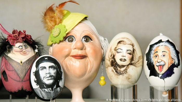 Several Easter eggs painted with iconic images, including Marilyn Monroe and Che Guevara.