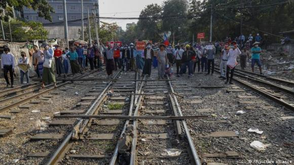 Anti-coup protesters in Mandalay block a railroad line last month