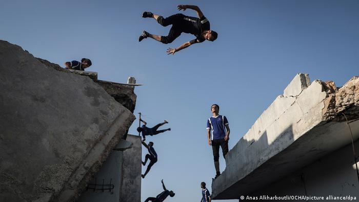 Anas Alkharboutli captures parkour athletes at destroyed buildings in 2020
