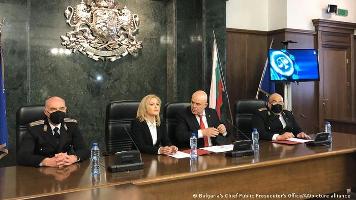 Four Bulgarian prosecutors and officials sitting at a press conference.