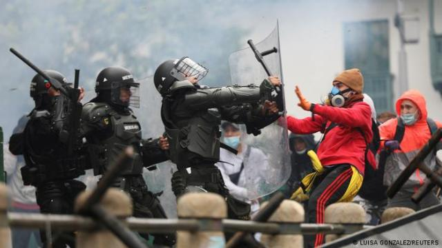 Protesters clash with security forces during a protest in Bogota.