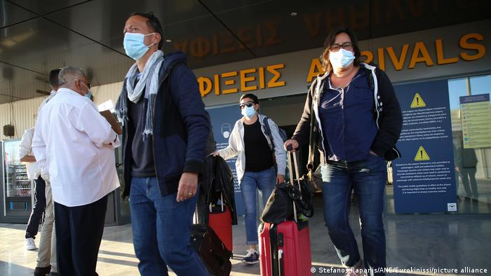 Masked passengers at the Heraklion airport.