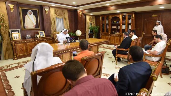 Qatari Attorney General Ali Bin Fetais Al-Marri (C) speaks to reporters in Doha on June 20, 2017.