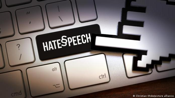 PIcture showing a keyboard with the words 'hate speech,'on it.