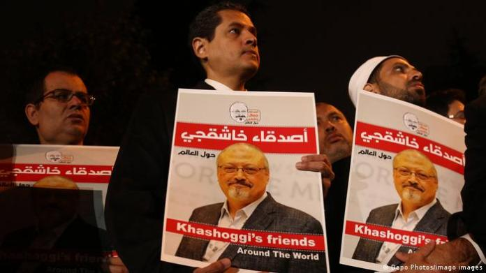 People hold pictures of Jamal Khashoggi during the demonstration in front of Saudi Arabian Consulate in Istanbul.