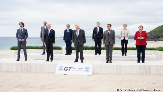 Group photo of G7 leaders on beach