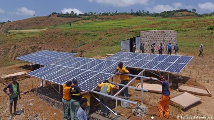 Near the village of Rema in Ethiopia, photovoltaic panels are mounted by a water tank to provide drinking water for the village