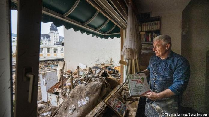 A hotel operator on the destroyed first floor of his hotel in Germany after floods