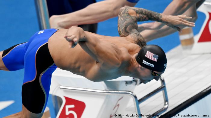Caeleb Dressel dives into the pool for the men's 100-meter freestyle final