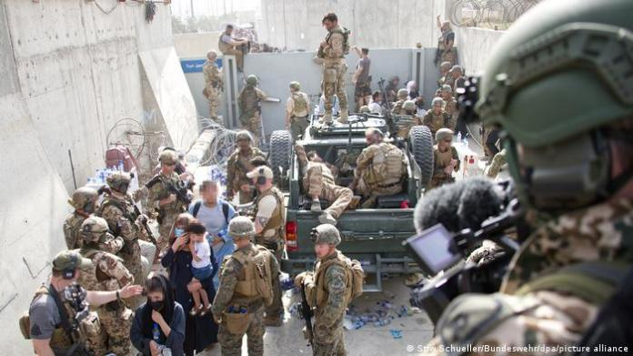 Soldiers try to bring order to chaotic Kabul evacuations