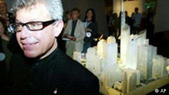 Daniel Libeskind stands in front of a model of Ground Zero.