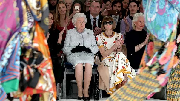 Latest pictures of Queen Elizabeth II as she appears at London Fashion Week