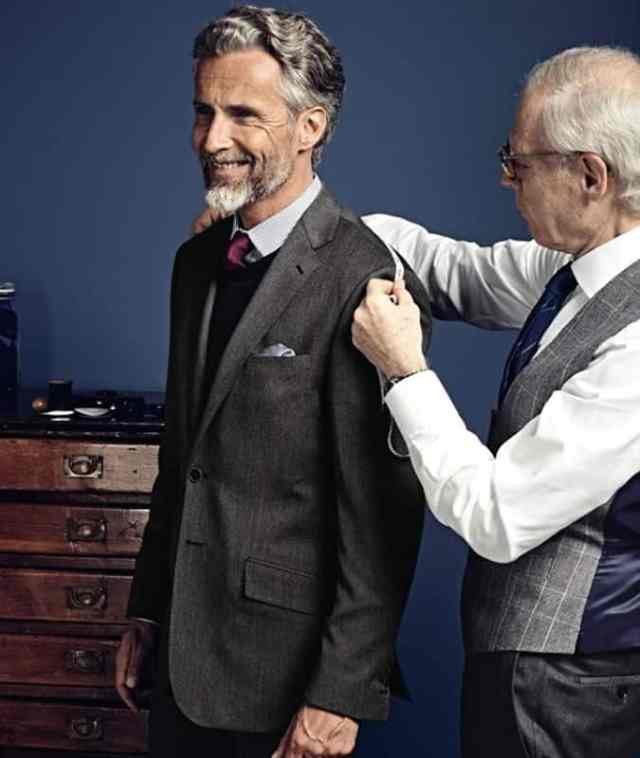 Man Being Fitted For A Suit By A Tailor
