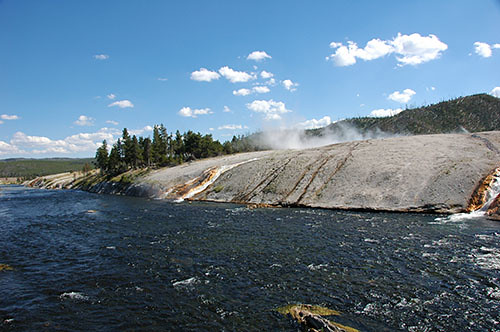 Yellowstone Midway Geyser - Hot water into cold river