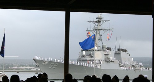 USS Russell passes in review.