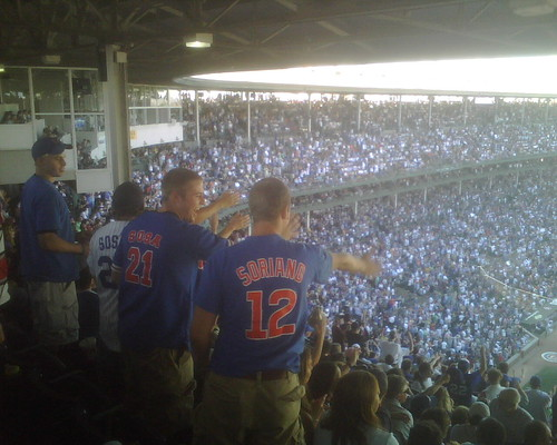 Cubs fans doing the tomahawk chop