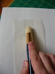 Brushing Glue on Mull