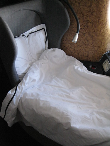 Seat as a flat bed with pillow and duvet