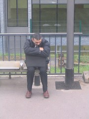 Image of a weary commuter waiting for his train