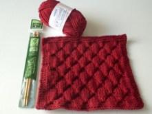 Smock Dishcloth with yarn and needle