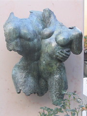 Image of a scupture of male and female torsos