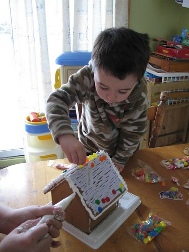 Xavier decorating the gingerbread house