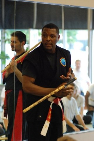 Master Peterson (foreground) and Me (in mirror) guest-teaching an Escrima (stick fighting) class