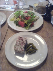 A Pigs face and crumbly goats cheese and watermelon salad