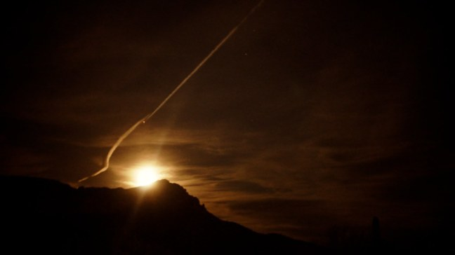 Moonrise with contrails over Pass Mountain