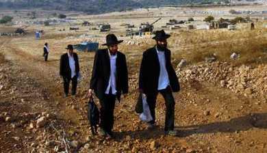 ultra-orthodox visit an artillery site, near Fassuta, Israel