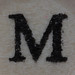 Wooden bead letter M