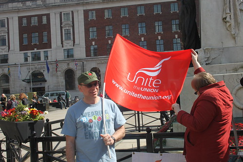 Former Leeds councillor and Pudsey Labour Party member John Garvarni unveils the Unite the Union banner.