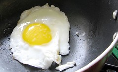 fried egg in non-stick pan