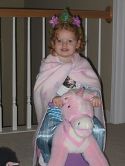 Ava with Crown and Cape on her Unicorn