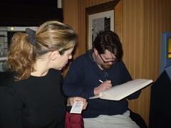 Jessy watches Hugh draw for Jeffrey