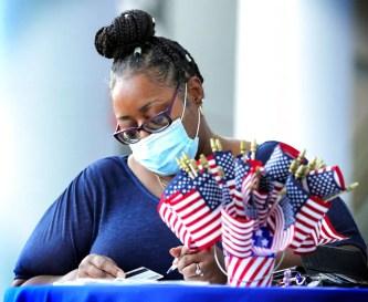 Florida election officials divided on enforcing mask mandate on Election Day