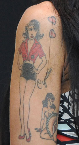 Amy Winehouse: Continuing her penchant for gaudy-as-hell tattoos,